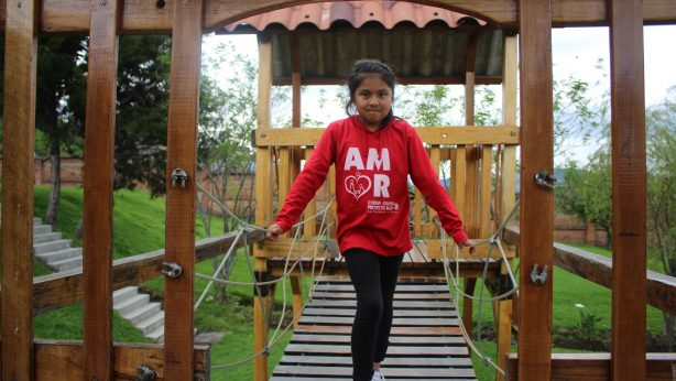 girl standing at playground of Project M25